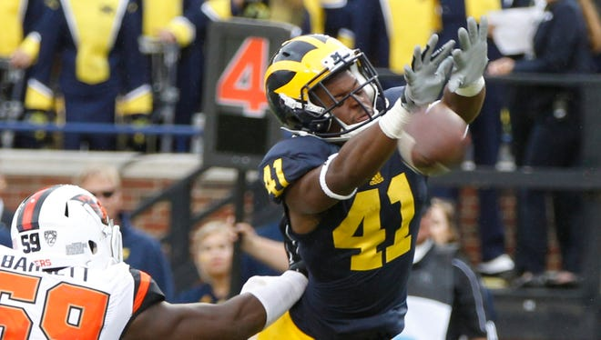 Michigan's Brian Cole just misses blocking punt by Oregon State in the third quarter at Michigan Stadium on Saturday, September 12, 2015, in Ann Arbor.