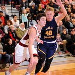 Newark's Hunter Dennison dodges Lancaster defender Rocky Jorgensen during Friday night's game. The Wildcats defeated the Gales 83-55.