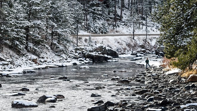 A man fishes on the Poudre River in February 2015. The basin's snowpack sits at 105 percent of average for this time of year, down from about 112 percent of the average two weeks ago