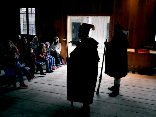 Historical interpreters Jim Evans and Steven Hamann educate visitors from Delton-Kellogg Elementary School at Colonial Michilimackinac in Mackinaw City.