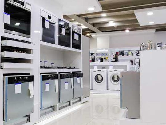 An appliance store with a number of appliances visible