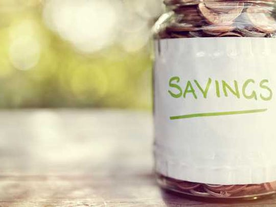 "A jar labeled ""savings"" filled with coins"
