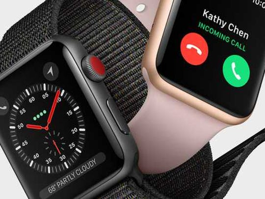 Two Apple Watches intertwined