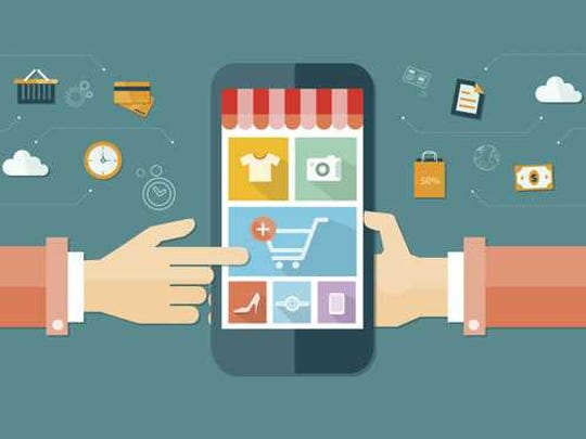 Cartoon graphic illustrating online shopping on a mobile phone.