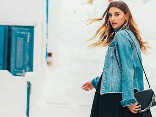 Fashionable woman looking back at camera.
