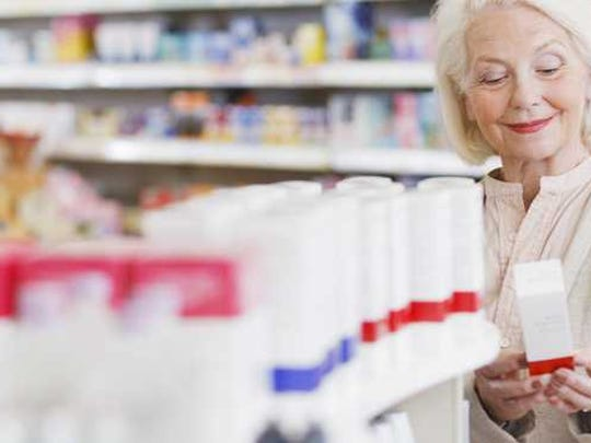 Older woman in a drugstore.