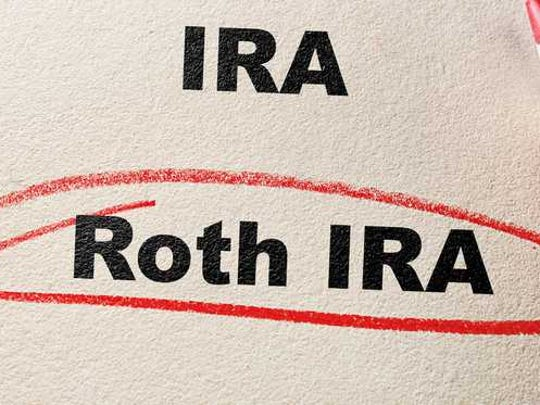 IRA and ROTH IRA typed on paper with ROTH IRA circled in red pencil.