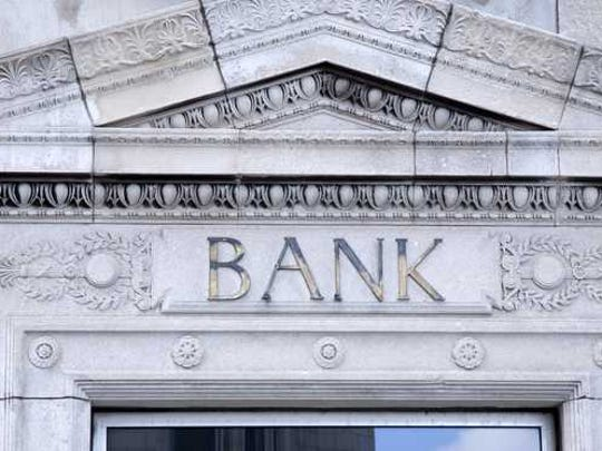 Front entrance of a stone bank building.