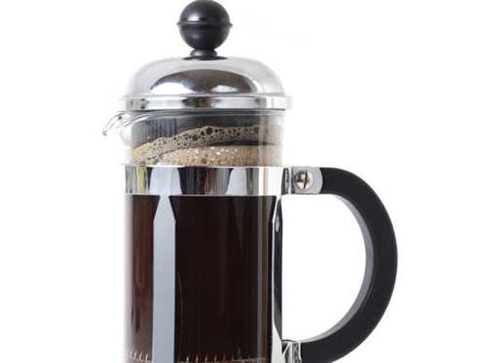A french press with coffee in it.