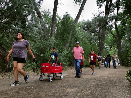 Community members walk through Farmington's Berg Park Wednesday during the Just Move It event.
