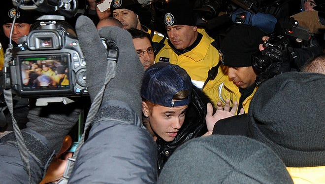 Justin Bieber turned himself in at a police station for an alleged criminal assault on Jan, 29, 2014 in Toronto.