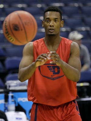 FILE - This Thursday, March 19, 2015, file photo shows Dayton's Dyshawn Pierre catching a pass during practice for an NCAA college basketball tournament second-round game in Columbus, Ohio. Pierre has sued the Ohio school in federal court over his suspension after a sexual assault accusation. Pierre's lawsuit asks a U.S. district court judge to order his reinstatement, and also seeks unspecified damages. (AP Photo/Tony Dejak, File)