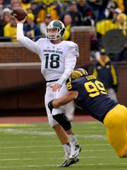 Connor Cook helped MSU beat Michigan this season, making several critical throws, despite regular pressure from the Wolverines.