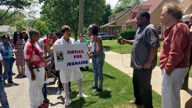 "Jermaine Claybrooks' aunt, Beverly Walker, holds a sign with Claybrooks' obituary and speaks to family and friends on June 25. ""He was, and still is, a beautiful person,"" she said. ""He was there for everyone."""