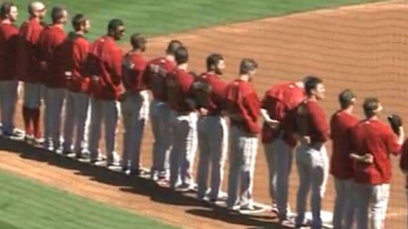 Arizona Diamondbacks players line up for the National