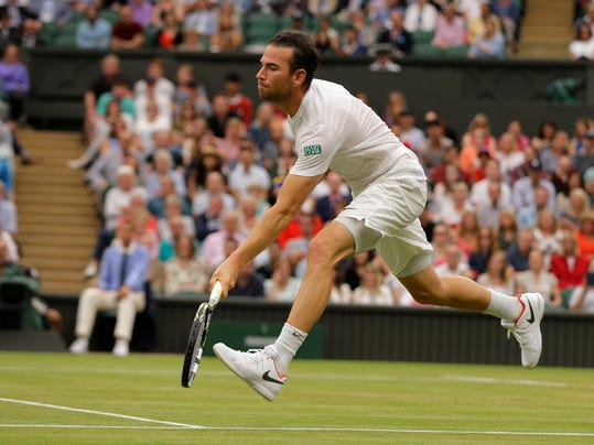Adrian Mannarino of France returns to Serbia's Novak Djokovic during their Men's Singles Match on day eight at the Wimbledon Tennis Championships in London Tuesday, July 11, 2017. (AP Photo/Alastair Grant)
