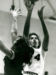 Betsy Witman shoots a jumper during her high school