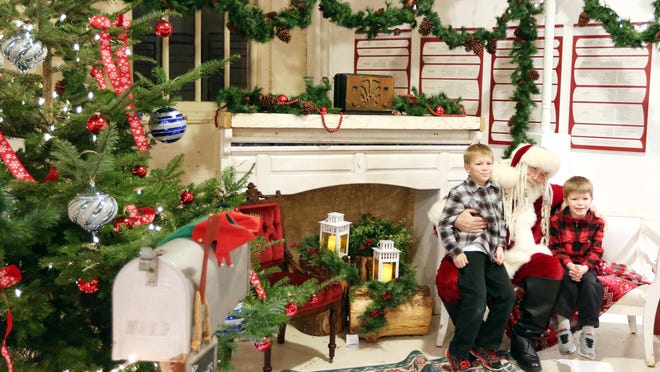 Cayden, 7, left, and Conner VanDeHey, 5, of Salem, visit Santa Claus during Magic at the Mill Saturday, Dec. 19, 2015, in Salem, Ore.