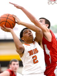 Dai-Quest Casiaro (2) helped lead William Penn to the District 3 Class AAAA boys' basketball semifinals with wins vs. Hempfield and Chambersburg this week. (Daily Record/Sunday News -- file)