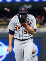 May 21, 2018; Minneapolis, MN, USA; Detroit Tigers reliever Warwick Saupold yells into his glove in the eighth inning against the Minnesota Twins at Target Field.