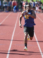 First day of Bergen County Track Championships at Old Tappan High School on Friday, May 11, 2018. Rayshawn Hammond, of Hackensack, on his way to finishing first in his division of the 100M.