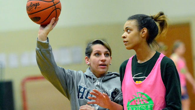 Ashton Hirsch (formerly Ashton Bankos) works with Jania Wright during a York Catholic practice, Wednesday January 6, 2016. Hirsch will take over as the girls' JV coach beginning this season. (John A. Pavoncello - The York Dispatch)