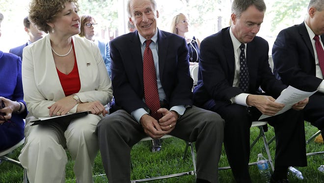 Rep. Susan Brooks (from left), Indiana Sen. Dan Coats and Indianapolis Mayor Joe Hogsett attended a naturalization ceremony  Friday morning, July 1, 2016. A total of 96 people from numerous countries took the oath of citizenship as the Benjamin Harrison Presidential home.