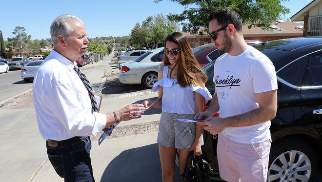 County judge candidate Ricardo Samaniego talks with Melanie Juarez and Fernando de Leon on May 5 in East El Paso as he block walks.