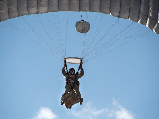 An Air Force pararescue member makes a training jump in Afghanistan with an Eder Flag Manufacturing Co. flag attached to his harness.