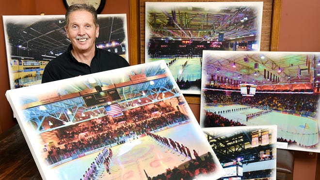 Randy Asseln shows some large canvas prints of hockey arenas. He takes photos and creates digital art at his home studio in St. Stephen.
