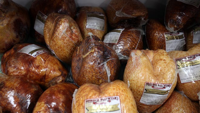 Smoked turkey breasts at Fisher Meats