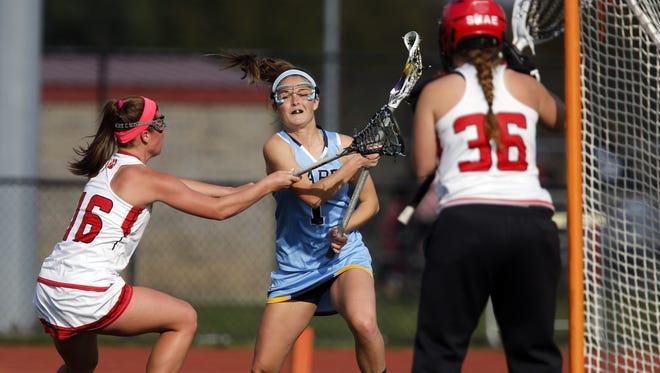 Cape Henlopen's Lizzie Frederick (1) had eight goals and six assists as the Vikings cruised past Caravel 20-7 Thursday night.