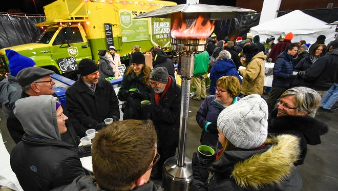 Food, warm drinks and heaters kept the visitors happy at the annual Weihnachtsmarkt, a Christmas market event,  Thursday, Dec. 8, under the new parking ramp next to River's Edge Convention Center.