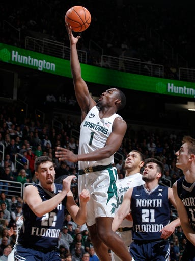 Michigan State's Joshua Langford (1) goes up for a