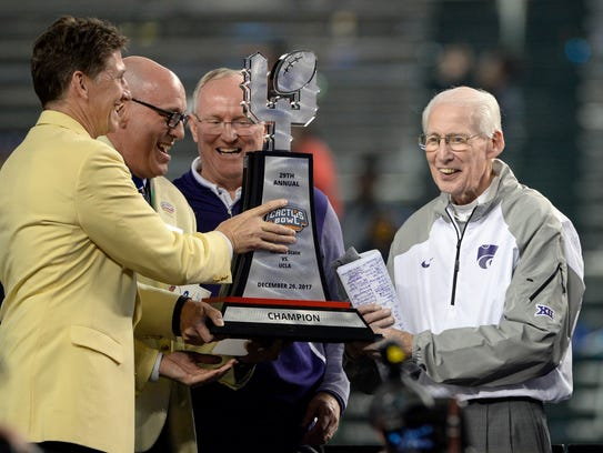 Kansas State coach Bill Snyder is presented with the