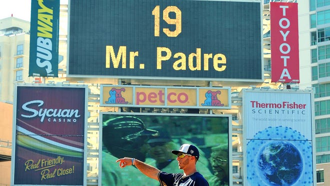 San Diego Padres first baseman Tommy Medica (14) gestures during batting practice before a game against the Seattle Mariners as a tribute plays in honor of former player Tony Gwynn (19) on the jumbotron before a game against the Seattle Mariners at Petco Park.