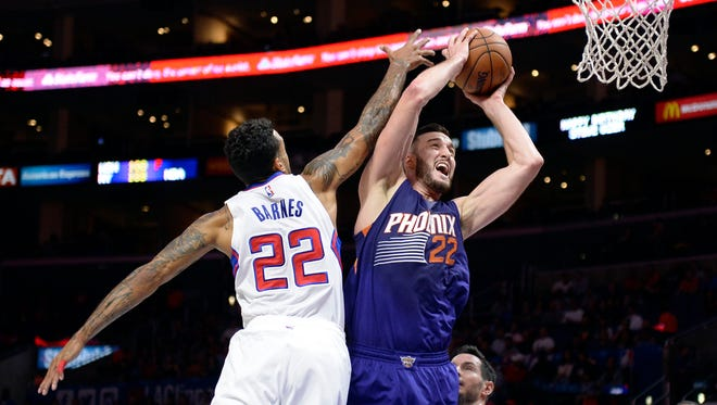 Phoenix Suns center Miles Plumlee (22) shoots against Los Angeles Clippers forward Matt Barnes (22) during the first half at Staples Center.