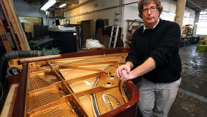 Joe Hanerfeld, owner of the Craftsman Piano workshop in the YoHo Arts complex on Nepperhan Avenue in Yonkers.