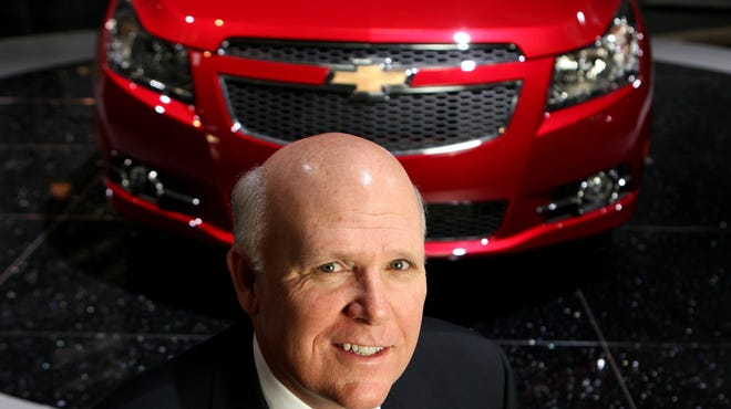 Dan Akerson, CEO of General Motors, with a Chevy Cruze LTZ in this 2011 file photo