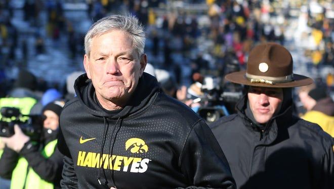 Iowa Hawkeyes head coach Kirk Ferentz leaves the field after beating the Purdue Boilermakers at Kinnick Stadium. Iowa beat Purdue 40-20.