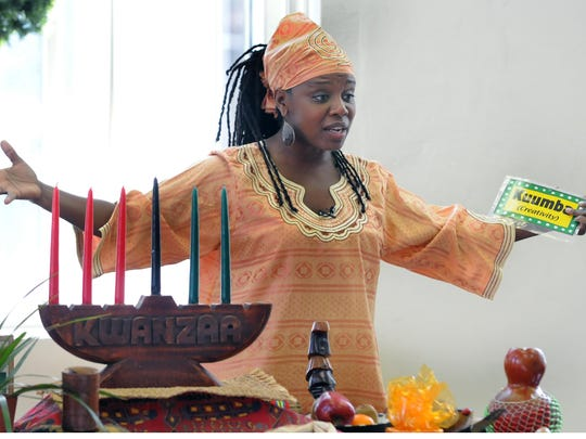 Storyteller Tahira tells children about Kwanzaa in 2011 at the Wilmington Library.