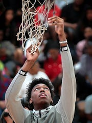 James Wiseman cuts a piece of net in the East High