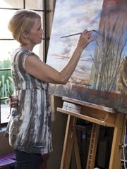 """Landscape artist Cyndy Carstens presents """"Glowing Symphonies"""" from 7-9 p.m. Nov. 13."""