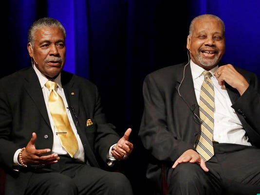 FILE - In this Sept. 27, 2016 file photo, Godfrey Dillard, left, and Perry Wallace take part in a lecture at Vanderbilt University in Nashville, Tenn.  Wallace, who broke down a racial barrier by becoming the first black varsity basketball player in the Southeastern Conference, has died. He was 69. Wallace's death was announced Friday, Dec. 1, 2017,  by Vanderbilt University, where Wallace became an all-SEC player and remains among the Commodores' all-time rebounding leaders. (AP Photo/Mark Humphrey, File)