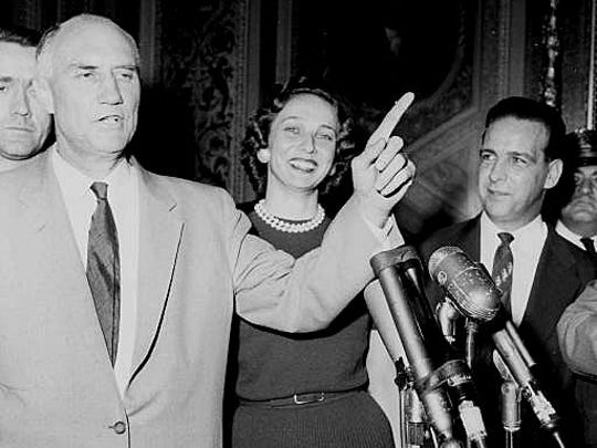 Performing for the benefit of newsmen, Sen. Strom Thurmond, demonstrates his oratory, minutes after he emerged Aug. 29, 1957 from the Senate chamber where he spoke a record-breaking 24 hours,19 minutes against the compromise civil rights bill. His wife, Jean who kept a sometimes lonely vigil as a one person audience in the Senate gallery, smiles in background. Thurmond who is retiring from serving 48 years in the U.S. Senate will celebrate his 100th birthday on Dec. 5, 2002. (AP Photo/File)