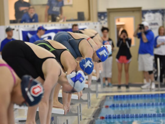 Anna McCahill (Closest), Ali Terrell (middle), Gabby Hoffman (far) take their mark in the 200 IM.