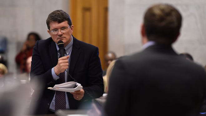 Rep. Mike Stewart faces Rep. Jeremy Durham during the House expulsion hearing for Durham Tuesday morning.