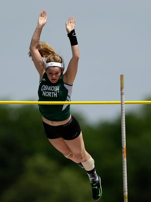 Oshkosh North's Erin Neveau clears the bar while competing in the pole vault during the 2016 WIAA state track and field meet.