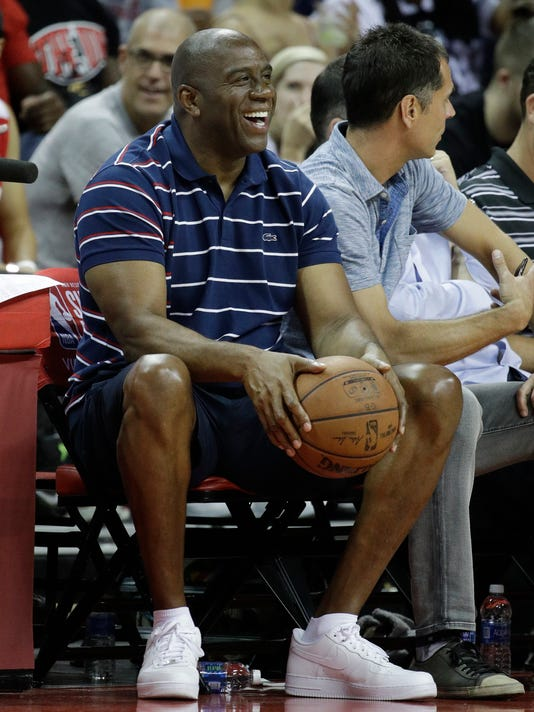 Magic Johnson watches the Los Angeles Lakers play the Portland Trail Blazers during the second half of the NBA summer league championship basketball game, Monday, July 17, 2017, in Las Vegas. (AP Photo/John Locher)