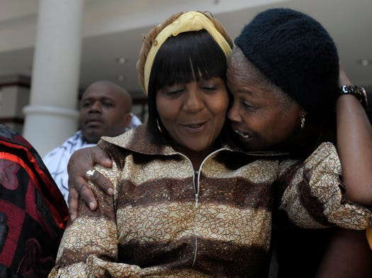Ndileka Mandela, the eldest granddaughter of Nelson Mandela, gets a hug from Nashville pastor Aola Hart on Saturday.